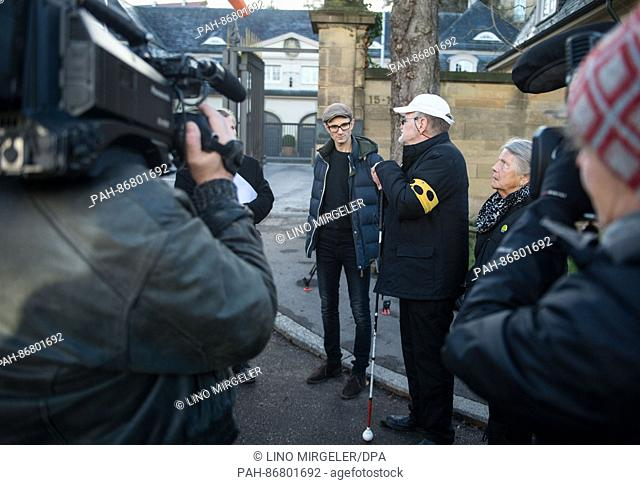 Daniel Kartmann speaks to journalists and the speaker of the State Ministry next to Dietrich Wagner and his life partner Erika Wagner outside the State Ministry...