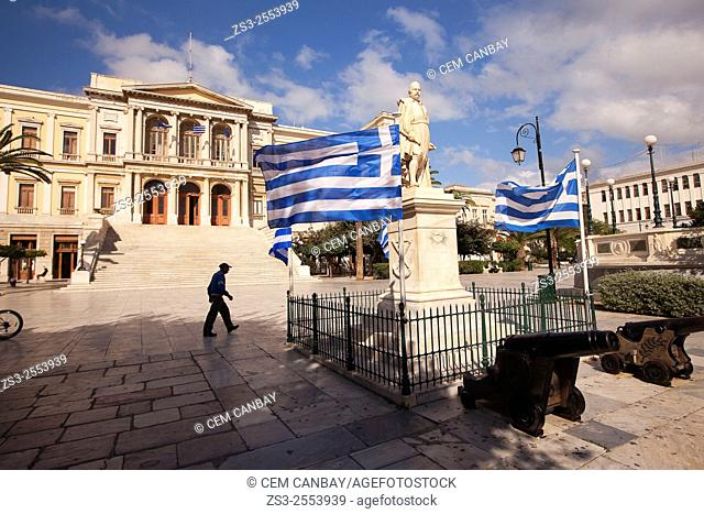 Greek flags in front of the Neo Classic City Hall of Ermoupolis in Miaoulis Square, Ermoupolis, Syros, Cyclades Islands, Greek Islands, Greece, Europe