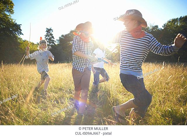 Group of young boys playing in field