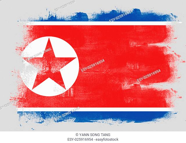 Flag of North Korea painted with brush on solid background
