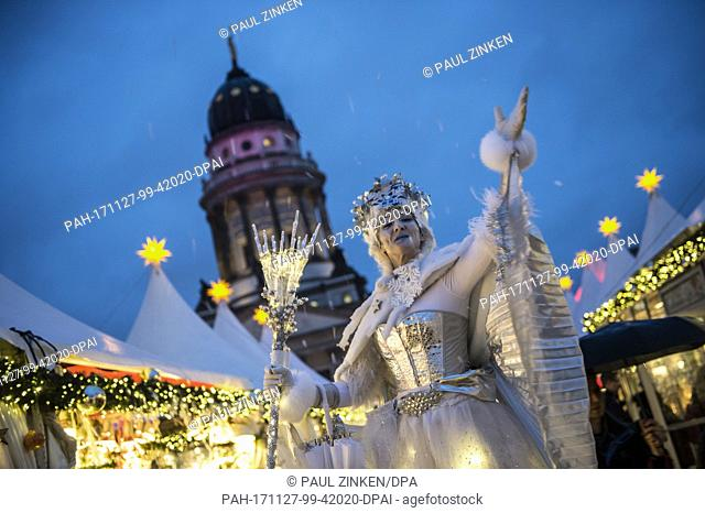 The snow queen greets visitors at the Gendarmenmarkt Christmas market in Berlin, Germany, 27 November 2017. The Christmas market in front of the the Konzerthaus...