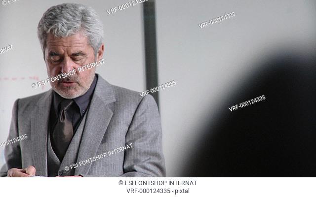 Lockdown, Medium shot, Businessman using a flipchart in a meeting