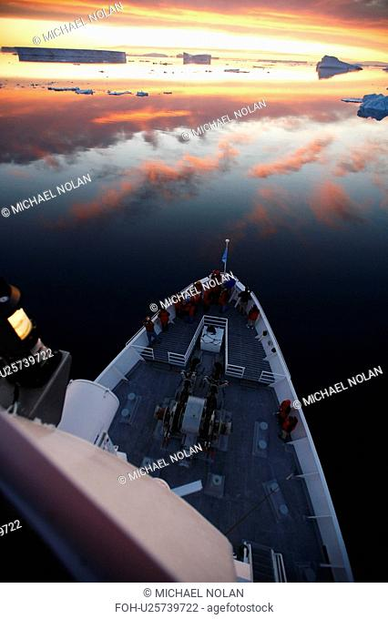 A view from the crow's nest of the National Geographic Endeavour at sunset in the Weddell Sea, Antarctica