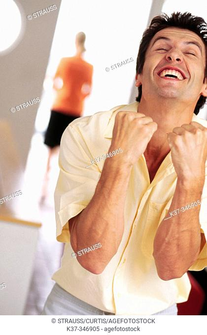 Young man expressing excitement over successful achievement