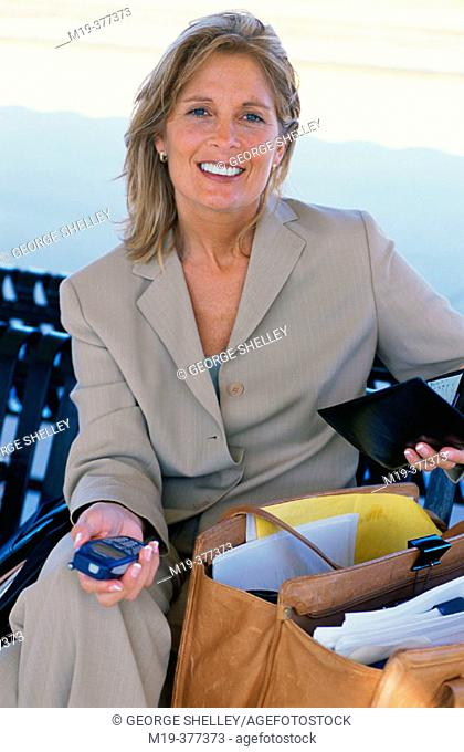 business woman working on an outdoor bench