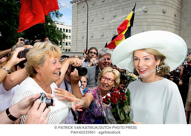 Queen Mathilde of Belgium (R) greets well-wishers after the Te Deum mass at the Cathedral of St. Michael and St. Gudula in Brussels, Belgium, 21 July 2015