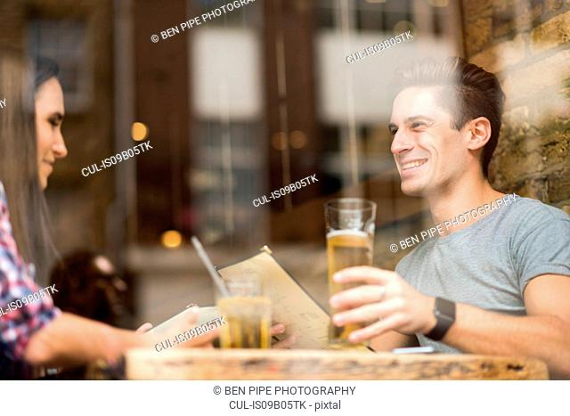 Window view of young couple in restaurant