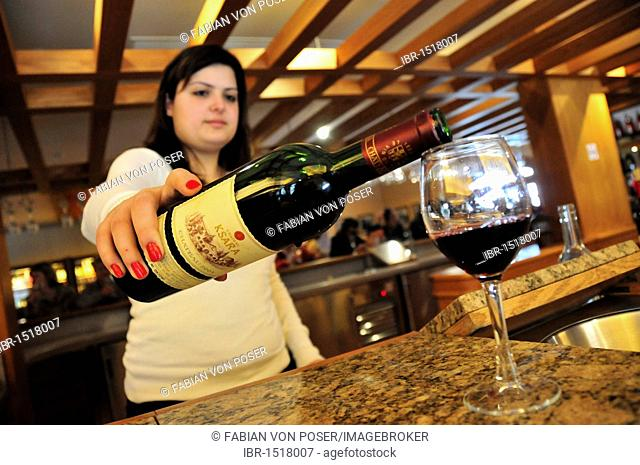 Wine tasting by a staff member of the largest Lebanese winery Ksara in Zahleh, Beqaa valley, Lebanon, Middle East, Orient