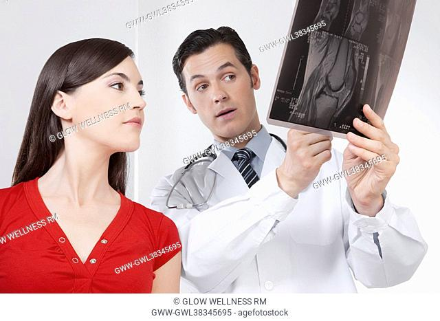 Doctor explaining x-ray report to a patient