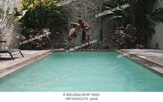 Father jumping in swimming with his children father enjoying with children