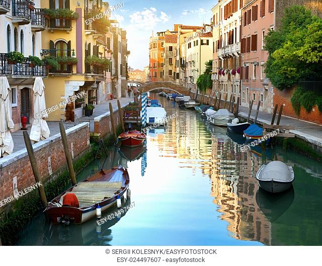 Canal of Venice and boats, Italy