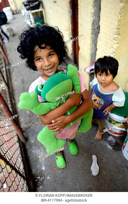 Girl, 8 years, boy, 5 years, in a house for the poor, Lima, Peru