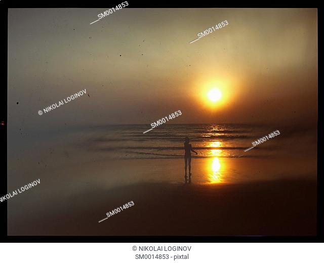 Horizontal vintage indian boy meeting sunset on the beach postcard background backdrop