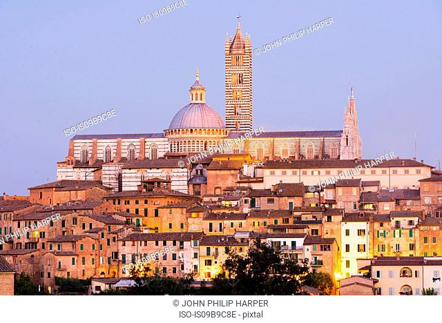 Cityscape view of Siena Cathedral at dusk, Siena, Tuscany, Italy
