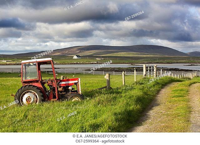 Old Massey Ferguson tractor on croft at Baile Mor, North Uist, Hebrides, Scotland, UK