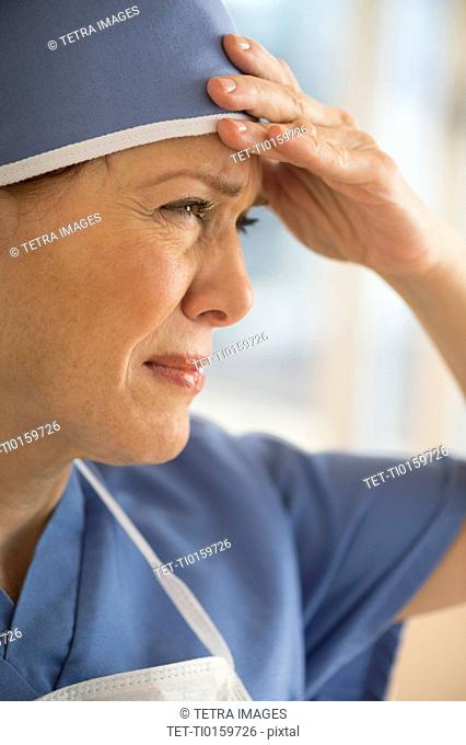 Female surgeon suffering headache
