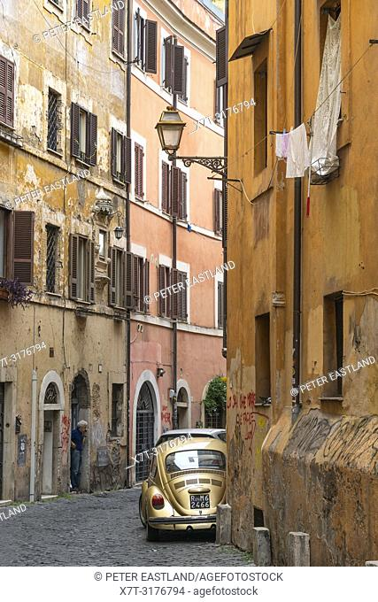 Old cars and colourful old houses in the Trastevere district of Rome, central Italy