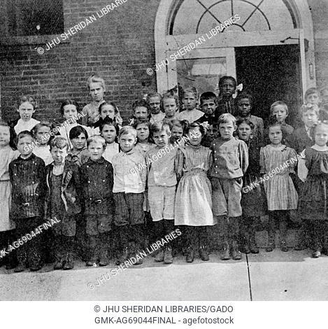 Full length landscape shot of schoolchildren, standing, some African American, 1915