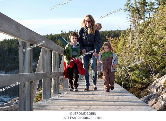 Mother and three children enjoying nature walk