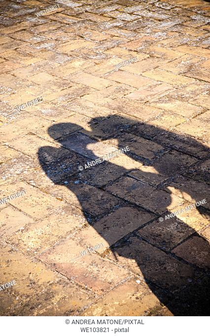 The shadow of a couple kissing in love
