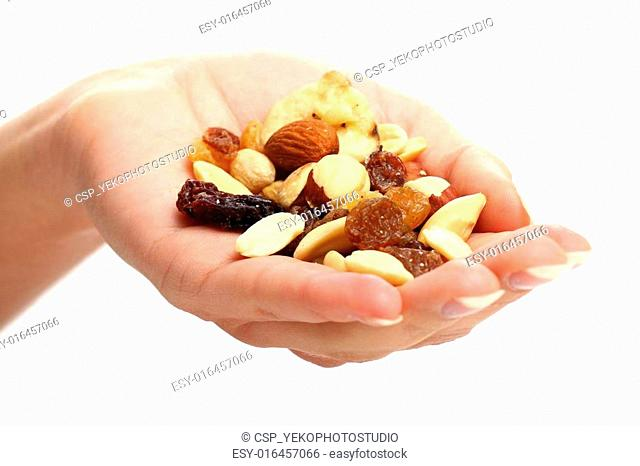 Hand with different dried fruits