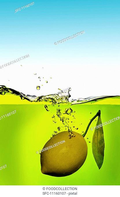 A lemon that has fallen into the water