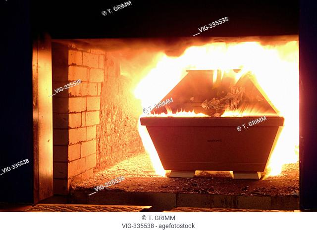 Cremation in Hamburg crematorium on the cemetery Hamburg Oejendorf. The picture shows a coffin on its way through the automatical entrance into the burner with...