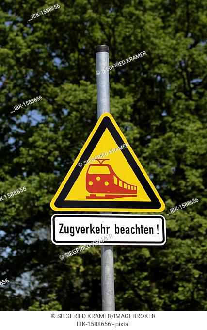 Zugverkehr beachten!, attention, trains crossing, sign on railway property
