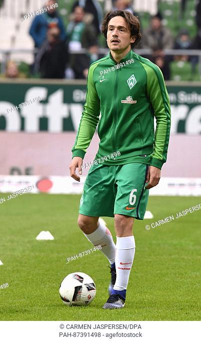 Werder's new player Thomas Delaney warms up ahead of the German Bundesliga soccer match between Werder Bremen and Borussia Dortmund in the Weserstadion in...