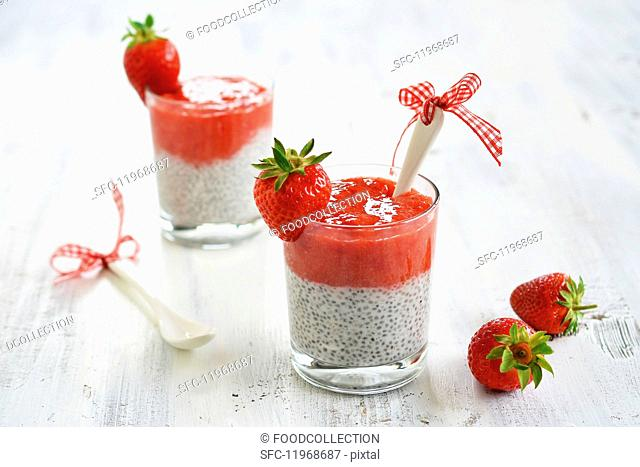 Dessert made from strawberry mousse with chia seeds in glasses garnished with fresh fruit