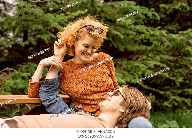 Couple relaxing on park bench