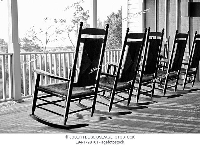 Black and white photo of rocking chairs on a porch of a home, North Carolina, USA