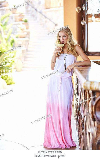 Caucasian woman having margarita at bar