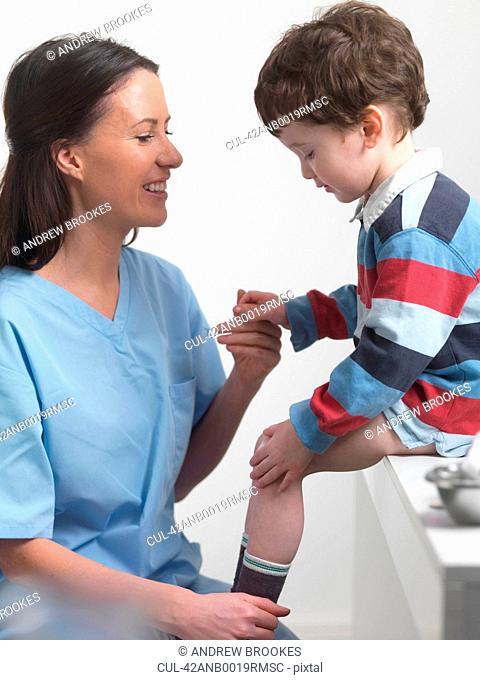 Nurse talking to boy in doctors office