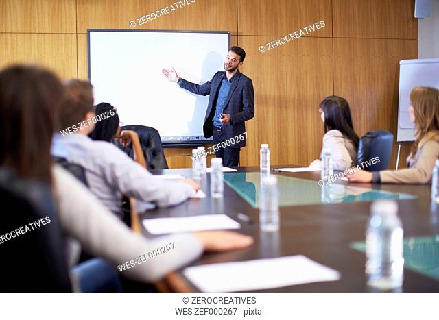 Manager leading business meeting in boardroom