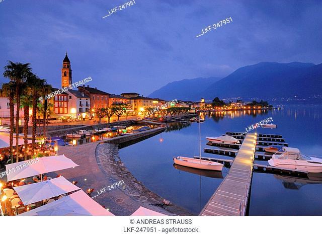Harbour with boats and illuminated seaside promenade in Ascona, Ascona, lake Maggiore, Lago Maggiore, Ticino, Switzerland