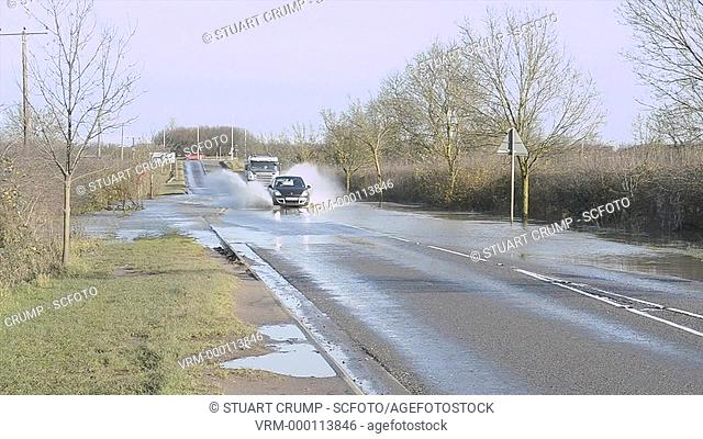 Traffic drives through the Floods in Mountsorrel, Leicestershire