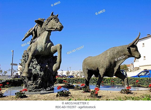Statue of guardian on Camargue Horse beside Camargue Bull, Les Saintes-Maries-de-la-Mer, Camargue, Bouches-du-Rhone, Provence-Alpes-Cote d'Azur, Southern France