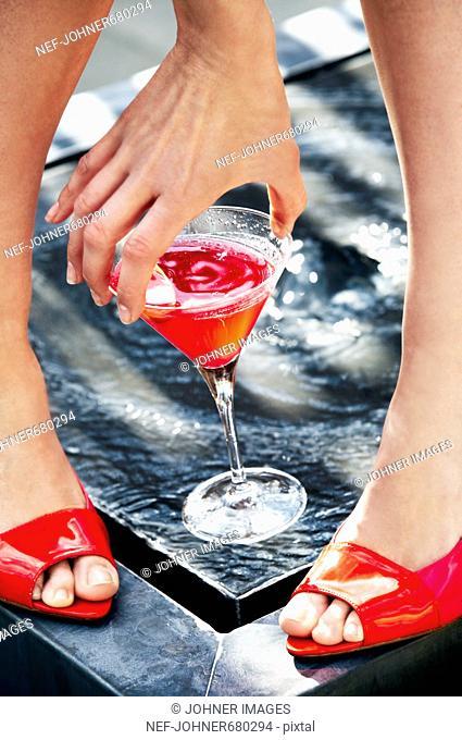 A woman holding a drink, Denmark