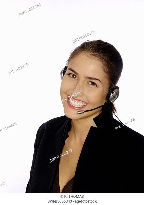 young woman / twen, wearing a business suit, talking on the phone with a headset, smiling at the camera
