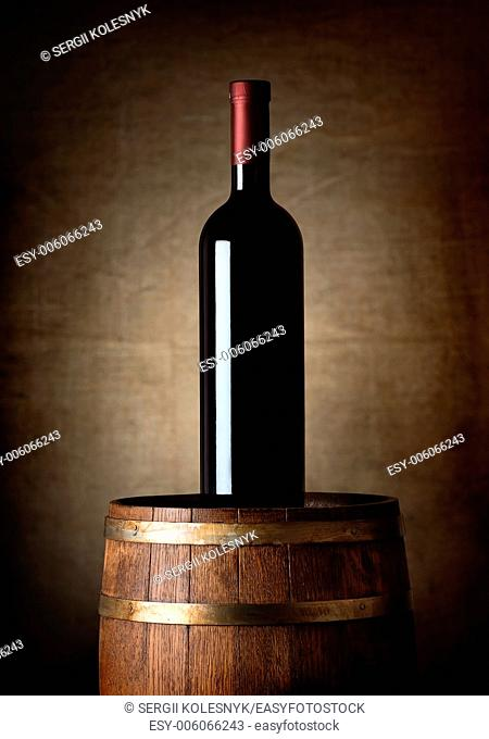 Bottle of wine on an old barrel