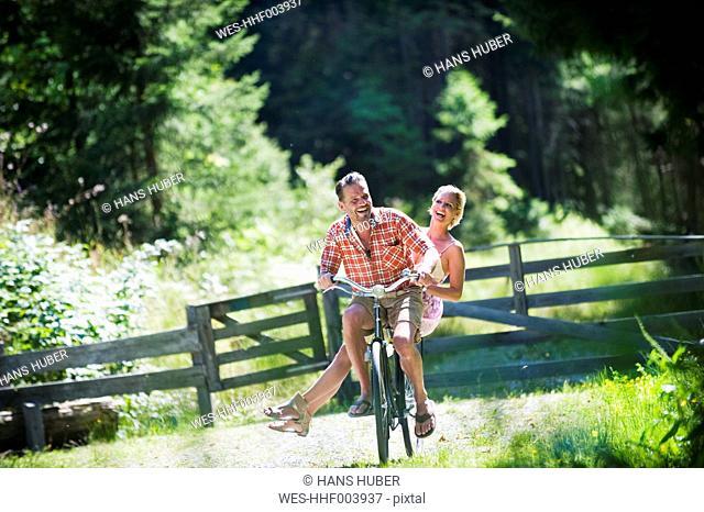 Austria, Salzburg County, Couple riding bicycle