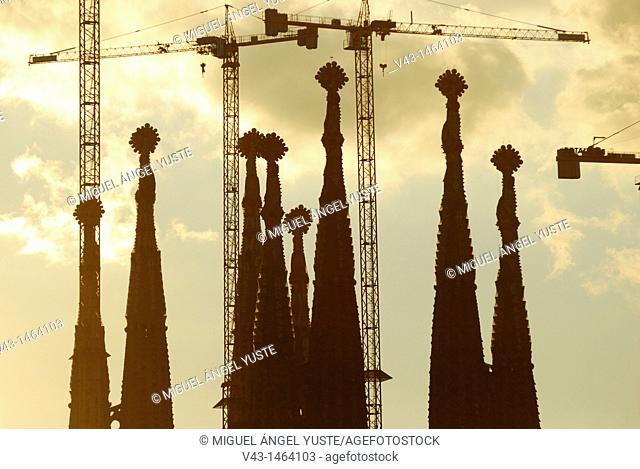 The Sagrada Familia towers and their cranes at dusk in Barcelona, Catalonia, Spain