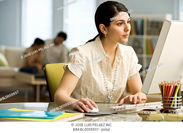 Middle Eastern businesswoman looking at computer