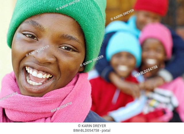 African girl with friends in background
