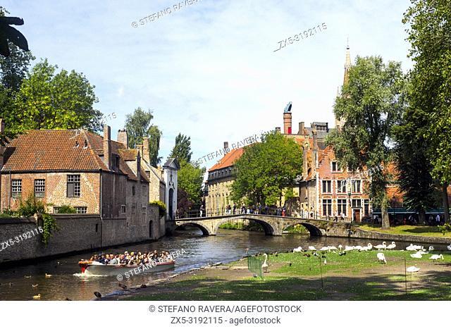 Canal and swans near Begijnhof - Bruges, Belgium