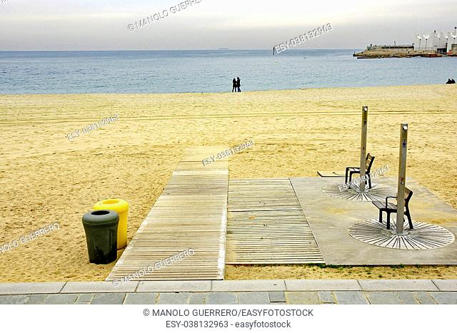 Showers and walkway on the beach of Nova Icaria, Barcelona, Catalunya, Spain