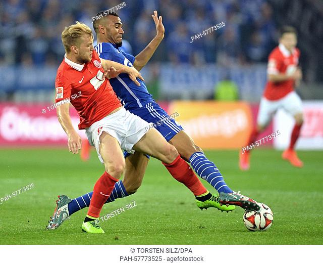 Johannes Geis of Mainz (L) and Schalke's Eric Maxim Choupo-Moting (R) vie for the ball during the German Bundesliga soccer match between 1