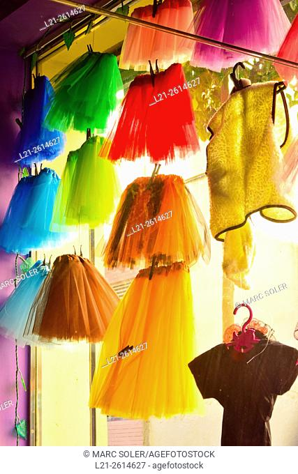 Colorful skirts hanging in a shop window