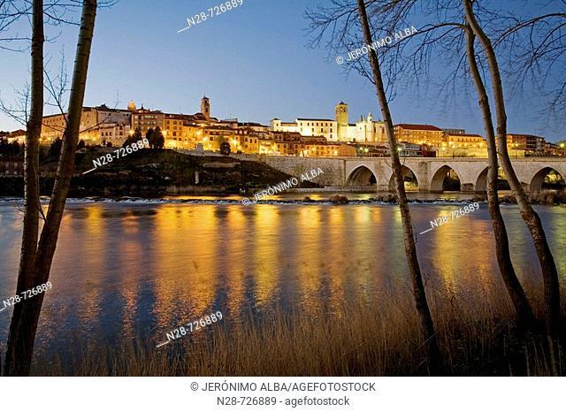 Medieval bridge and Duero river at dusk, Tordesillas. Valladolid province, Castilla-Leon, Spain